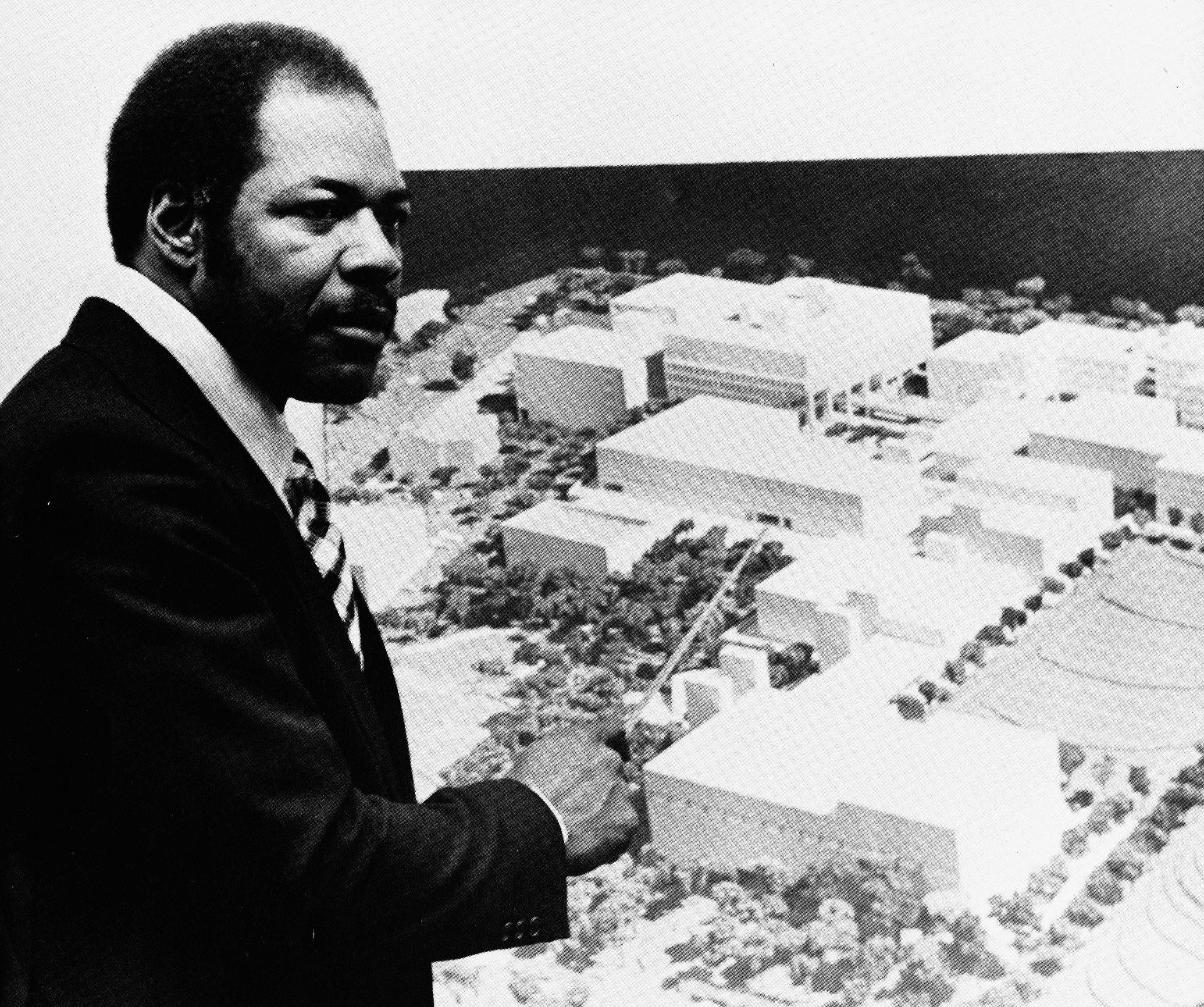 Washington Technical Institute -- President Dennard with plans for new WTI Campus, ca. mid 1970s